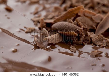 image of grated chocolate with melted chocolate