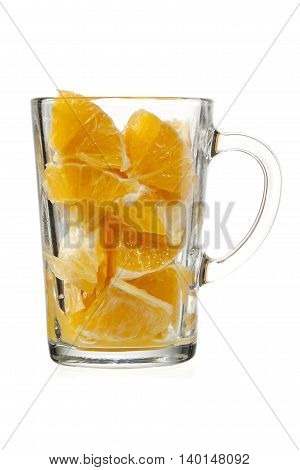 orange pulp in glass isolated on white background