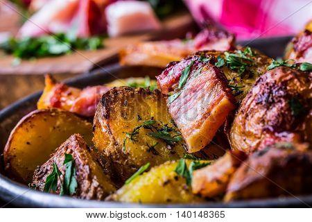 Potato. Roasted potatoes. American potatoes with smoked bacon garlic salt pepper cumin dill parsley - herb decoration.
