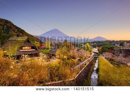 Mt. Fuji, Japan with historic village Iyashi no Sato during autumn.