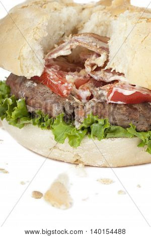 damaged hamburger isolated on a white background