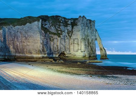 Natural cliffs on Alabaster coast Normandy in Etretat at evening France