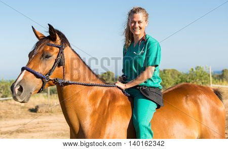 Equine veterinary at the equestrian riding a horse