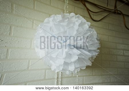 Paper white pompon for party, wedding. Close