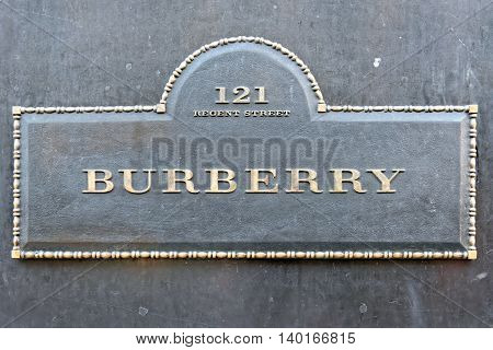 LONDON UNITED KINGDOM - JULY 1 2014: Burberry flagship store sign on Regent Street London. The brand was founded by Thomas Burberry in 1856.