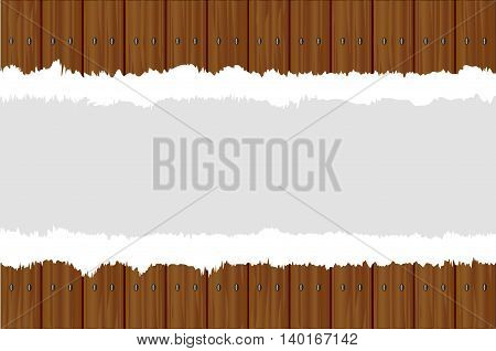 A fence made of dark stained wood planks with a paper tear placed in the center