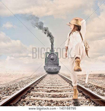 little explorer running in front of an steam locomotive