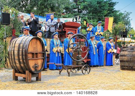 CHUSCLAN, FRANCE - OCTOBER, the 13, 2012: Vintners in traditional costumes during 14th festival