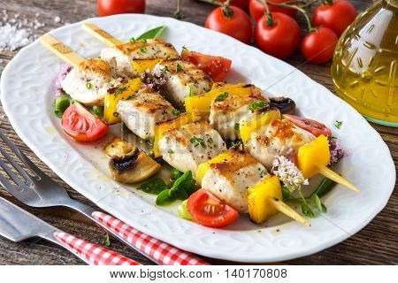 Griled Chicken Skewers On Wooden Background