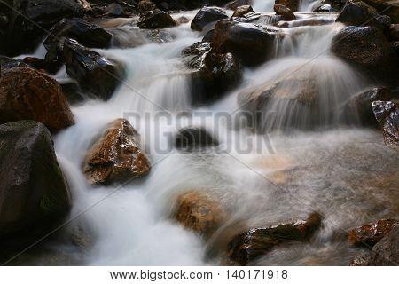 Cascading water over a Colorado mountain stream