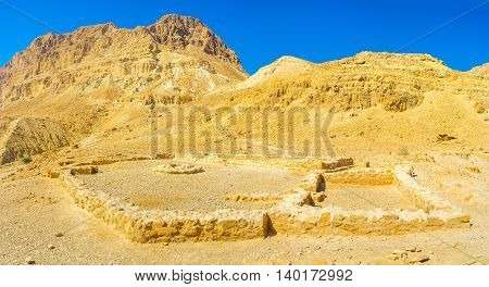 The ruins of the Chalcolithic Temple of Ein Gedi located among the desert mountains Israel.