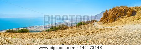 Panorama of the Dead Sea coast from the rock in Judean Desert Ein Gedi Israel.