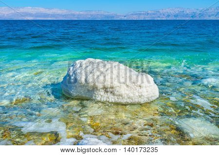The white stone in the Dead Sea covered with salt Ein Gedi Israel.
