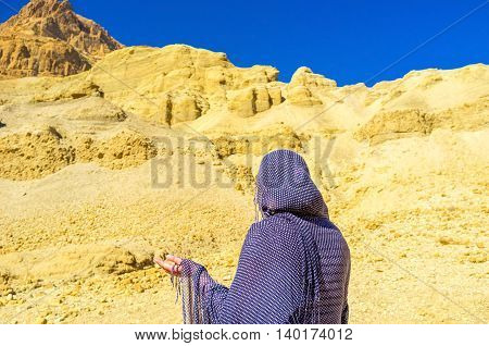 The dry and silent desert is the nice place for the prayer Ein Gedi Israel.
