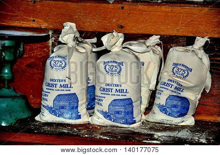 Sandwich Massachusetts- July 13 2015: Bags of stone ground corn meal are sold at 1636 Dexter's Grist Mill on Cape Cod