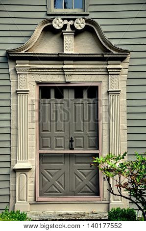Stockbridge Massachusetts - September 16 2014: Split scroll doorway at the 1742 Mission House built by Rev. John Sergeant a minister who came to convert the Mohican Indians to Christianity