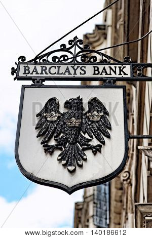 LONDON - JULY 1 2014: Vintage sign of Barclays bank branch in the City of London. Barclays was founded in 1690 and currently employs 146100 staff (2011).