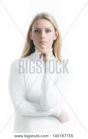 Beautiful Russian blonde girl on a white background in a turtleneck
