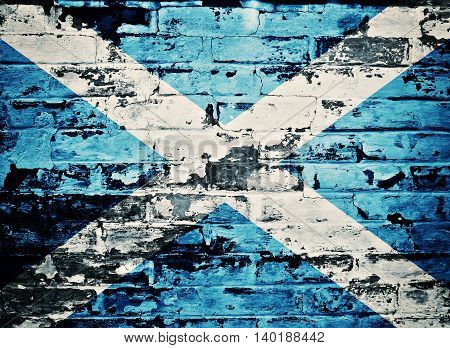 flag of Scotland painted on old brick wall
