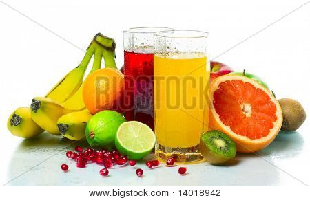 Collection of a ripe wet tropical fruits with juice glasses