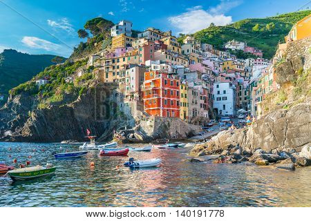 RIOMAGGIORE ITALY - JULY 4 2016: The viallage of Riomaggiore is one of the five villages along the Cinque Terre in Italy
