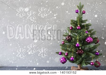 Christmas Tree With Purple Christmas Tree Balls And Snowflakes. Card For Seasons Greetings. Gray Cement Or Concrete Wall For Urban, Modern Industrial Styl. German Text Danke Means Thank You