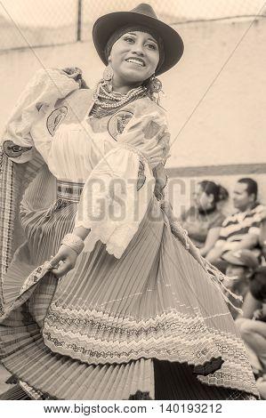 Banos De Agua Santa Ecuador - November 29 2014: Unidentified Youth Indigenous Woman Dancing On City Streets Of Banos De Agua Santa South America Monochrome Shoot