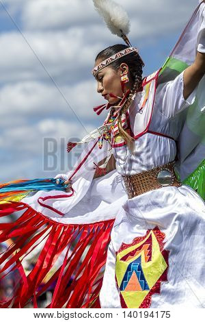 Coeur d'Alene Idaho USA - 07-23-2016. Sideview of beautiful Native American woman. Young dancer participates in the Julyamsh Powwow on July 23 2016 at the Kootenai County Fairgrounds in Coeur d'Alene Idaho.