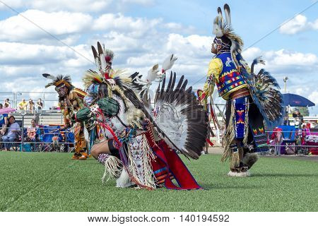 Coeur d'Alene Idaho USA - 07-23-2016. Dancers at a Native American powwow. Young dancers participate in the Julyamsh Powwow on July 23 2016 at the Kootenai County Fairgrounds in Coeur d'Alene Idaho.