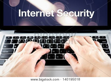 Hand Type On Laptop With Internet Security On Screen With Blur Background, Internet Security Concept