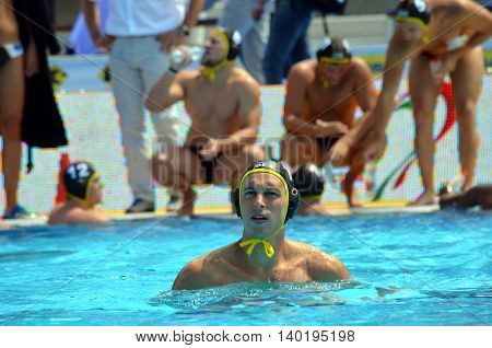 Budapest Hungary - Jul 14 2014. Germany's Moritz Oeler in the focus the german team in the background. The Waterpolo European Championship was held in Alfred Hajos Swimming Centre in 2014.