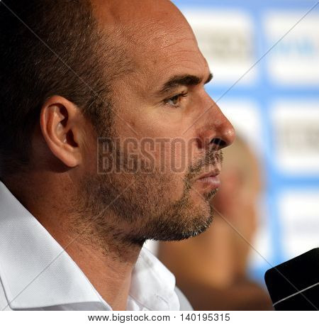 Budapest Hungary - Jul 14 2014. Tibor Benedek (Hungary) head coach talking after Spain-Hungary preliminary match. The Waterpolo European Championship was held in Alfred Hajos Swimming Centre in 2014.