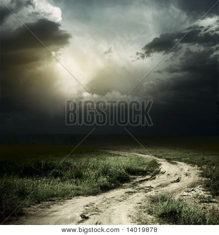 Rural road and dark storm clouds