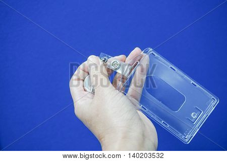 Isolated woman hold plastic nametag in hand