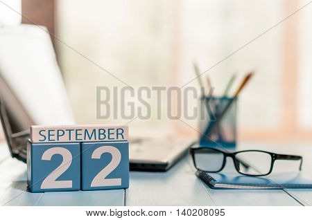 September 22nd. Day 22 of month, calendar on Programmer Analyst workplace background. Autumn time. Empty space for text.