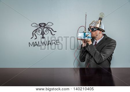 Malware text with vintage businessman kissing machine