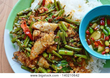 spicy stir-fried morning glory with dolly fish on rice