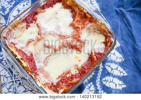 flat lay of a glass blowl of bolognese lasagne