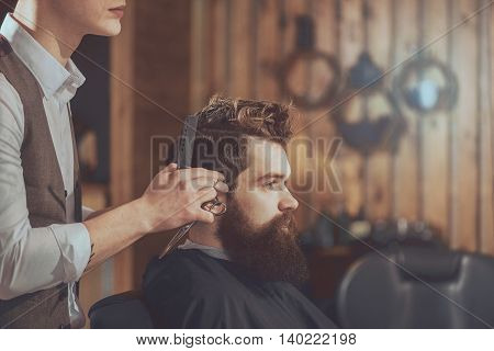 Cool haircut. Cropped image of men's haircut at the barber scissors