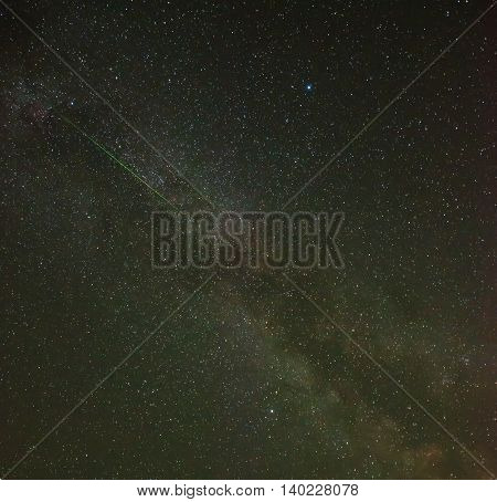 Milky way with shooting star over Slovenia, central Europe