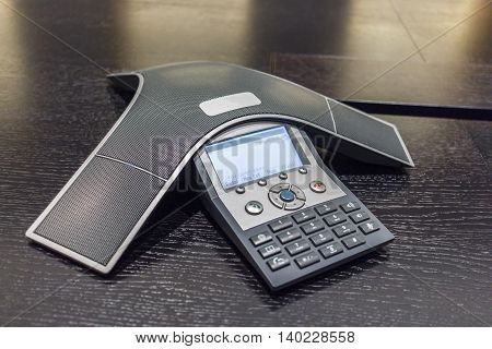 Close up shot of an office conference phone