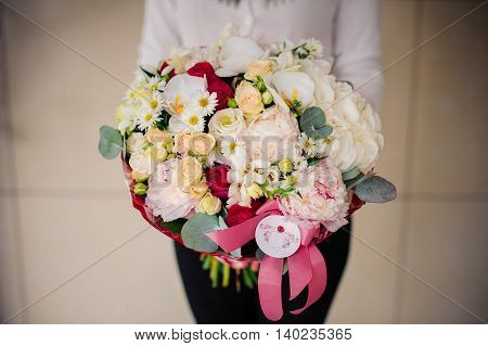 girl holding a big bouquet of white flowers