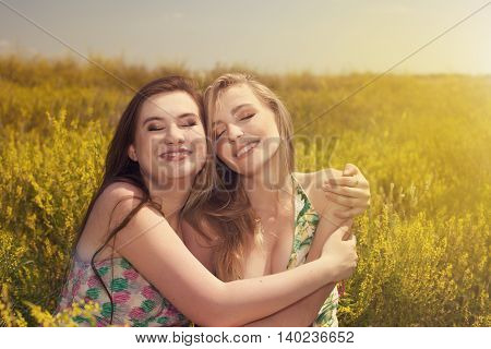 Two Beautiful Young Women Having Fun In The Nature