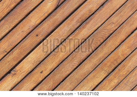 Wooden light brown table with diagonal boards.
