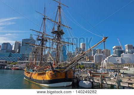 SYDNEY, AUSTRALIA - APRIL, 2016 : View of Tall Ship HMB Endeavour mooring in front of the Australian National Maritime Museum, Darling Harbour in Sydney, Australia on April 21, 2016.