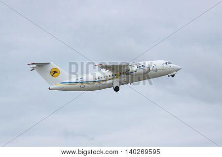 Borispol Ukraine - October 2 2011: Antonov An-148 regional passenger plane is taking off into cloudy sky and retracting its gear