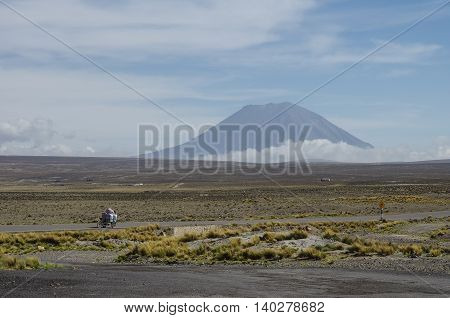 View Of Volcano Near Arequipa From Viewpoint In Altitude 4910 Meters. Highway In Andes Mountains Pla