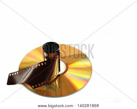 Film roll and compact disk on white background