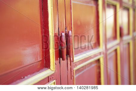 Close up of oriental details on wooden door and windows in the Forbidden City of Imperial Royal Palace of Nguyen dynasty in Hue, Vietnam.