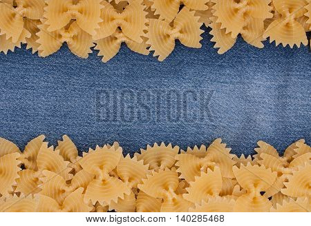 Background Of Italian Pasta, Pasta Made From Durum Wheat In The Shape Of A Butterfly Or Bow Knot On